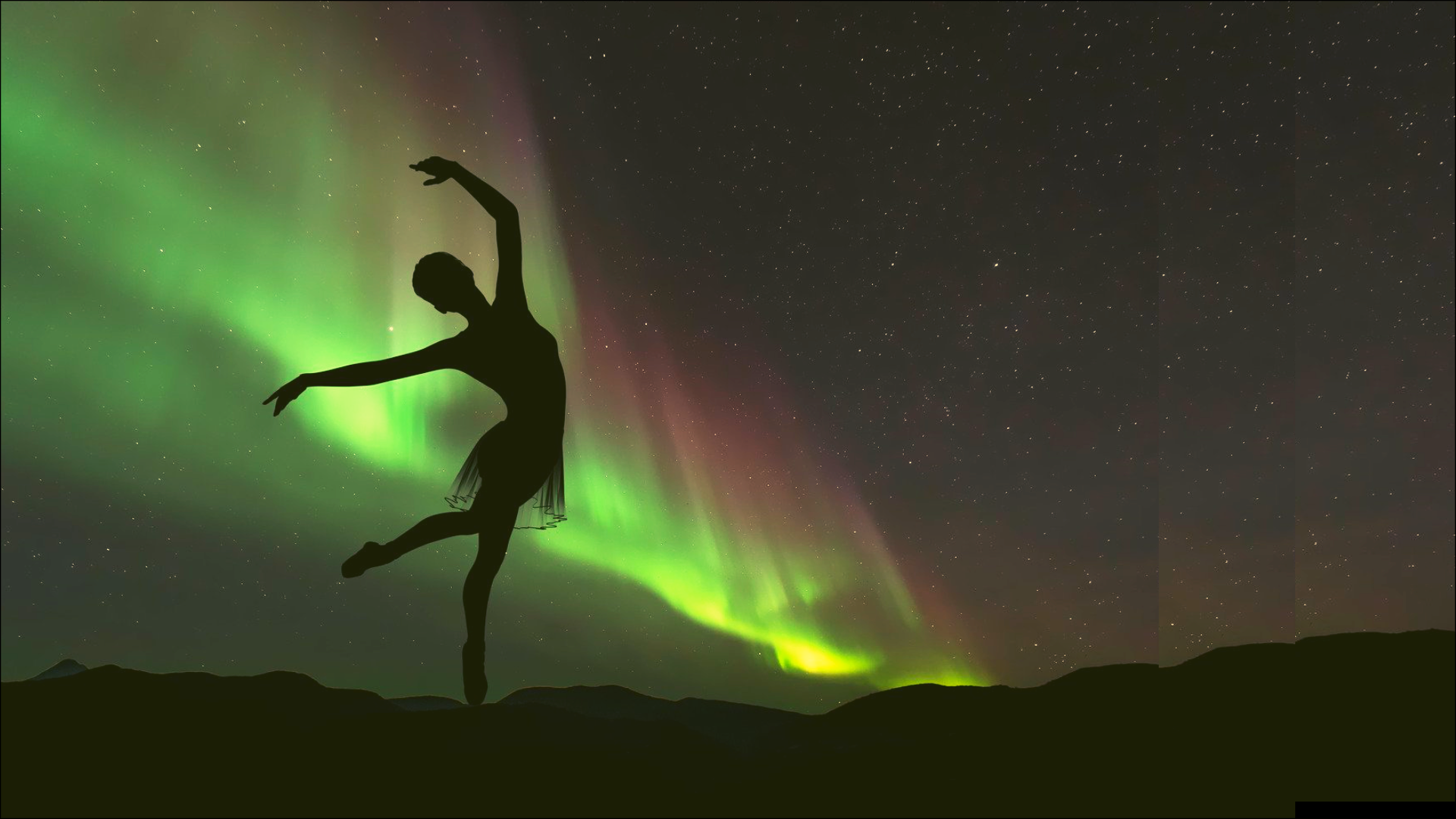 Silhouette female dancer on green northern lights background